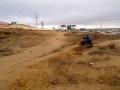 Pushing the bike into Aktau