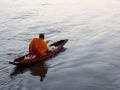 Alms by canoe