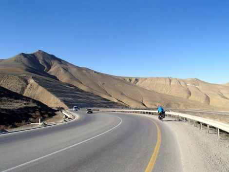 Katie cycling in the desert. Truly epic scenery!