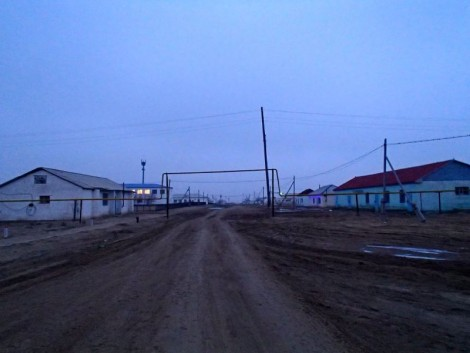 Akzhigit town entrance (the buildings on the right are the shops).