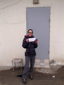 Katie rejoicing at having the tickets in her hands. The ticket office is through that door!