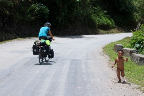 This little lad chased Katie for about 200 metres all the time yelling sa-bai-dee and helping to push.